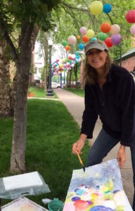 Kathleen Conover painting at Plein Air event in Marquette, MI